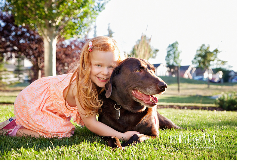 girl-and-lab-image_bonding_dog_hugs_kid_with_lab_photo