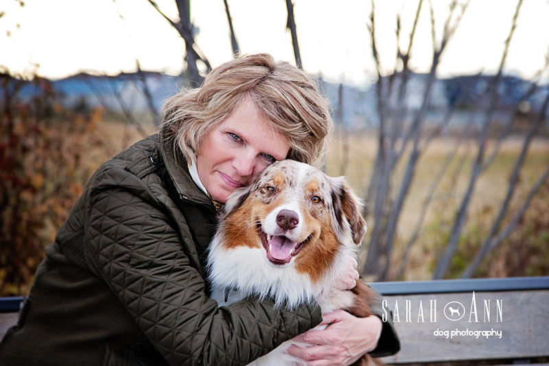woman hugging aussie shepherd dog calgary pet photography
